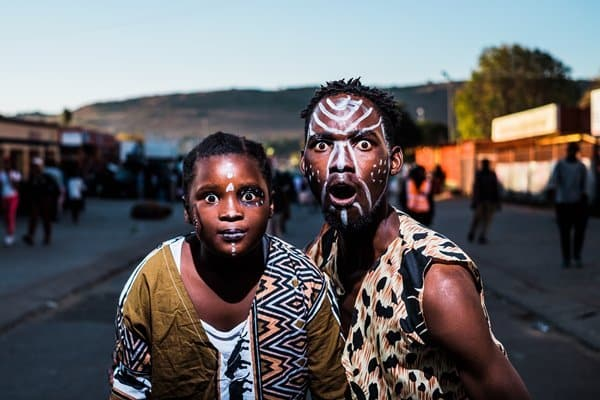 two guys in face paint wearing shocked expression