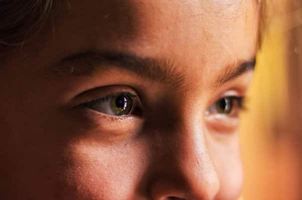 close up shot of a young girl with blue eyes