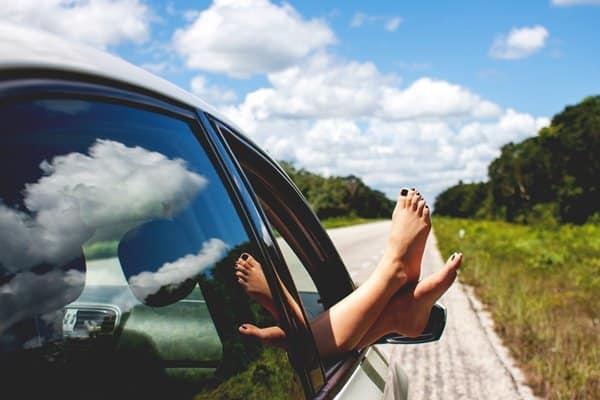 feet peeking outside the car window