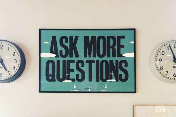 """Framed image of text """"Ask More Questions"""""""