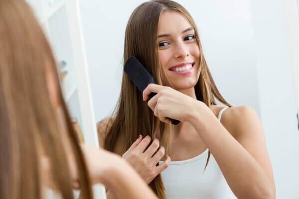 Woman brushing her beautiful long hair